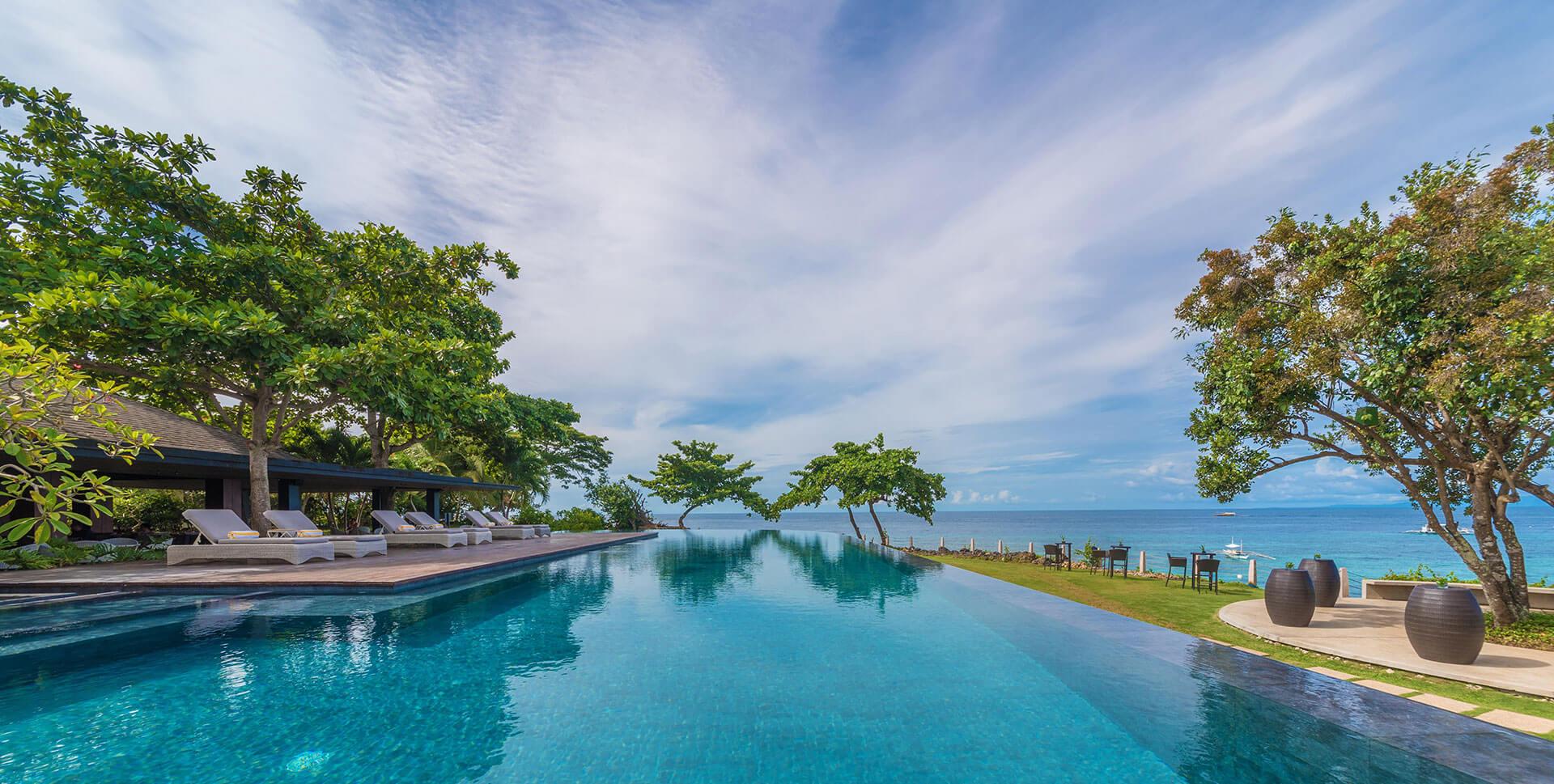 Blue waters of Amorita Resort's inifinity pool