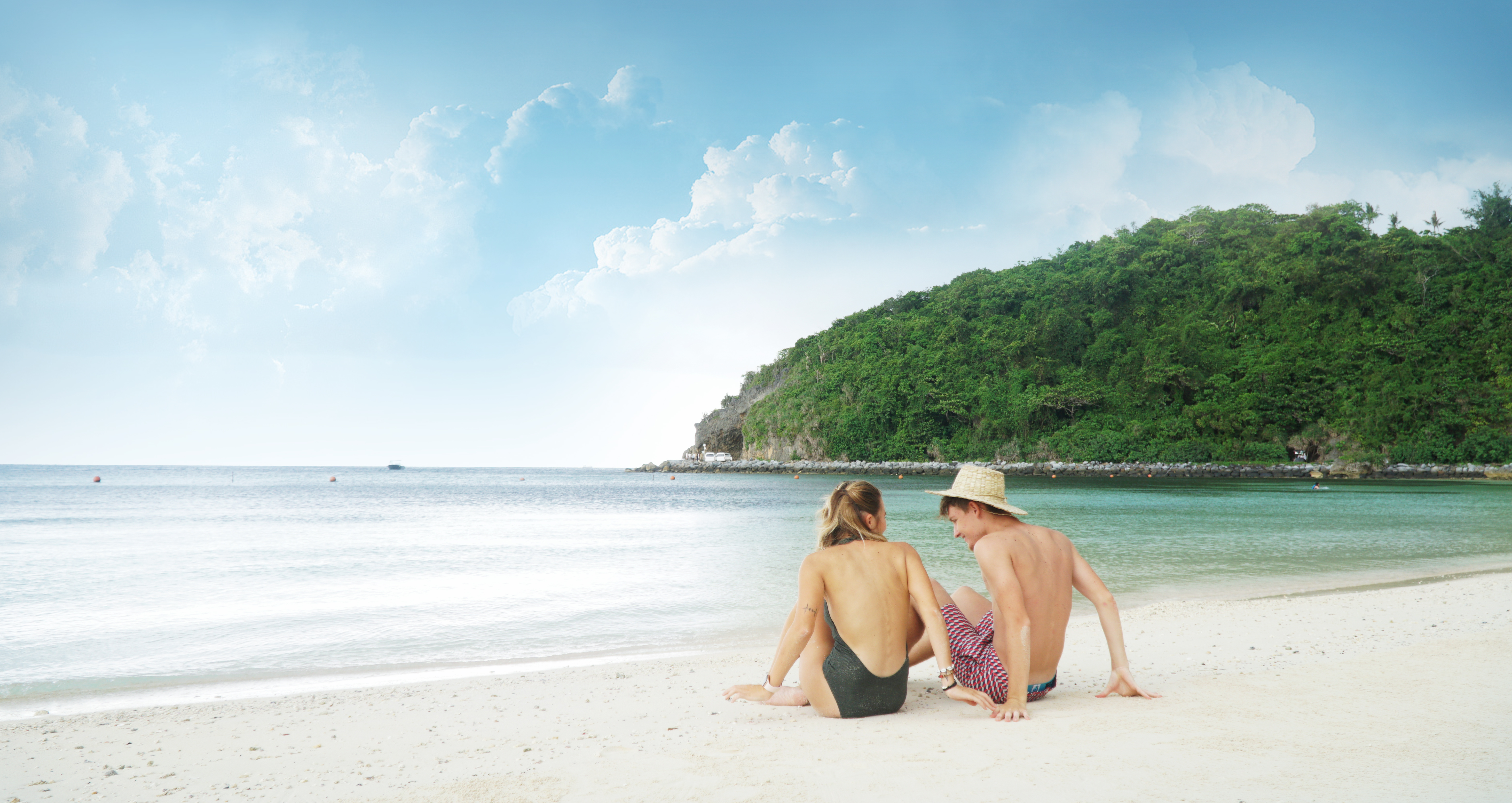Couple enjoying the private beach of Bluewater Resort
