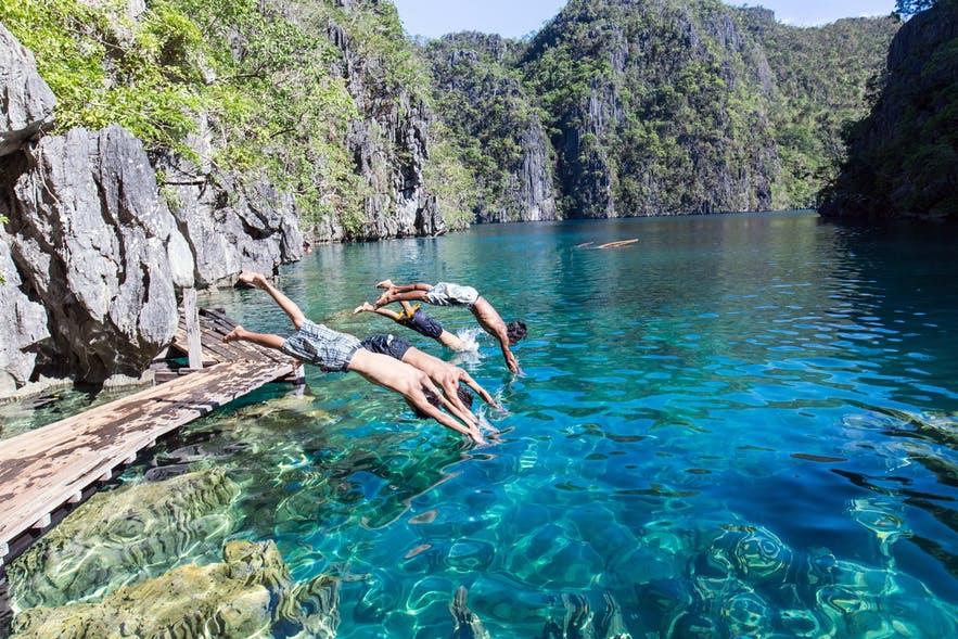 People diving to Kayangan Lake in Coron