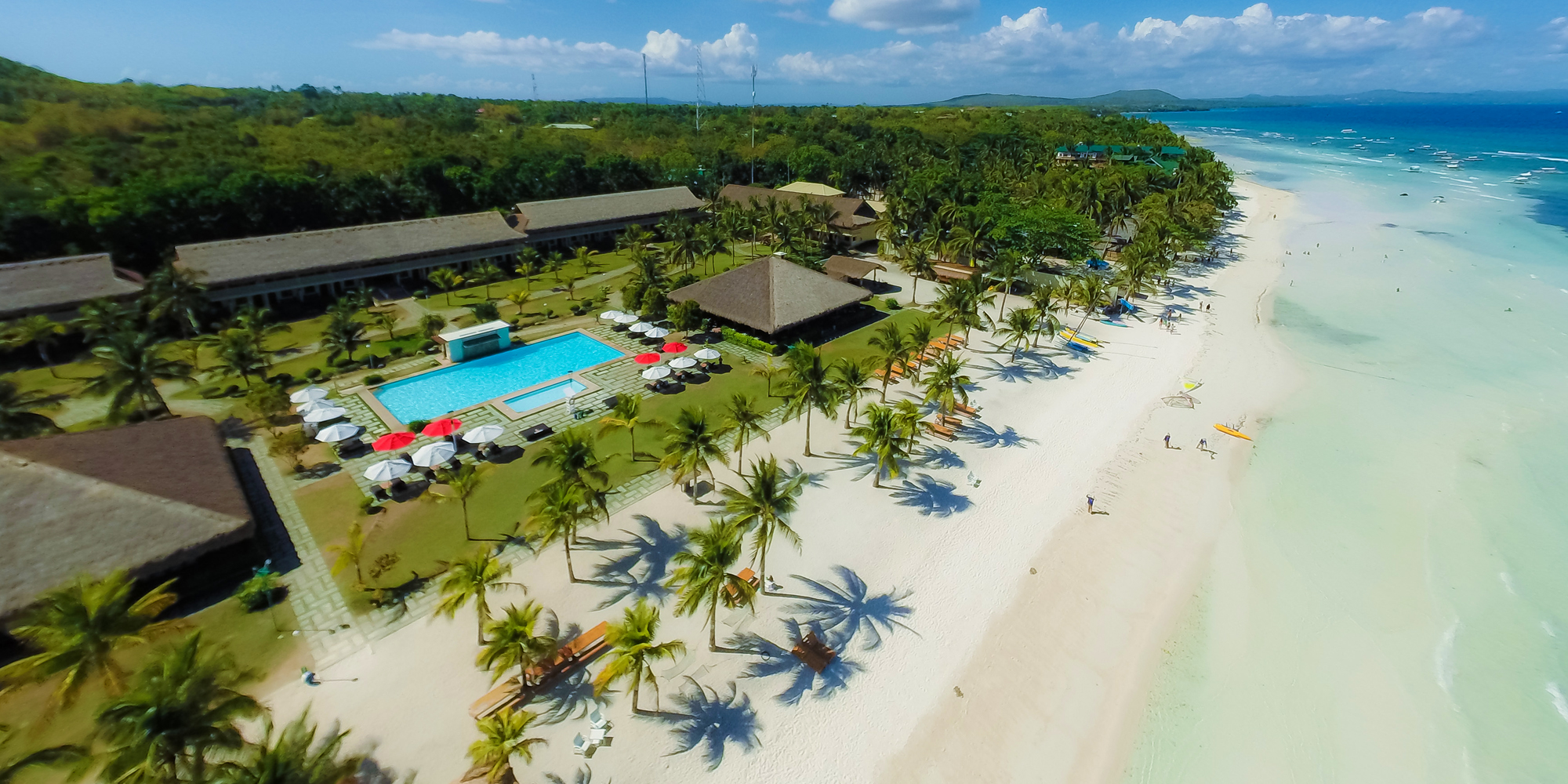 Aerial view of Bohol Beach Club Resort showcasing the pool, and wide private beach