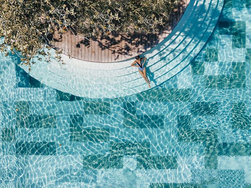 Woman in a pool of Amorita Resort
