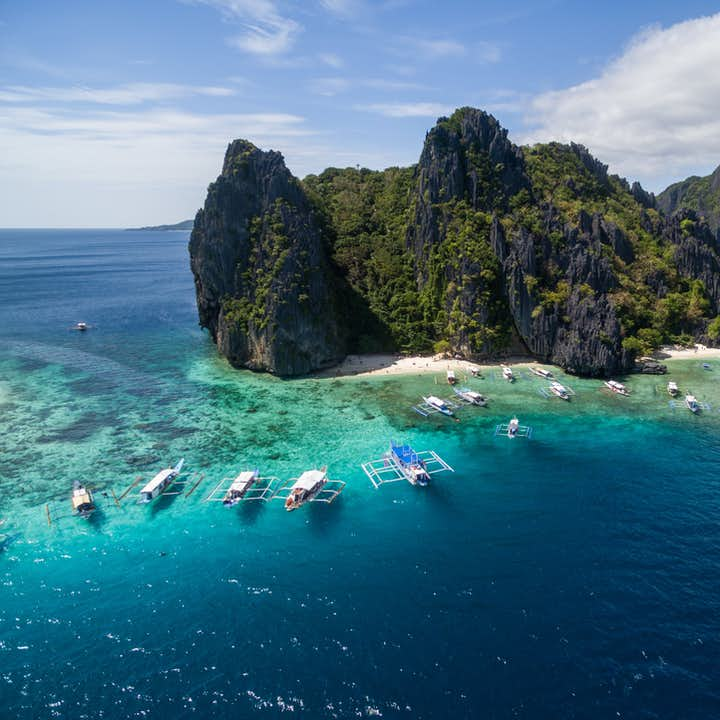 Sky-high rock formations and deep blue waters in Shimizu Island, Palawan