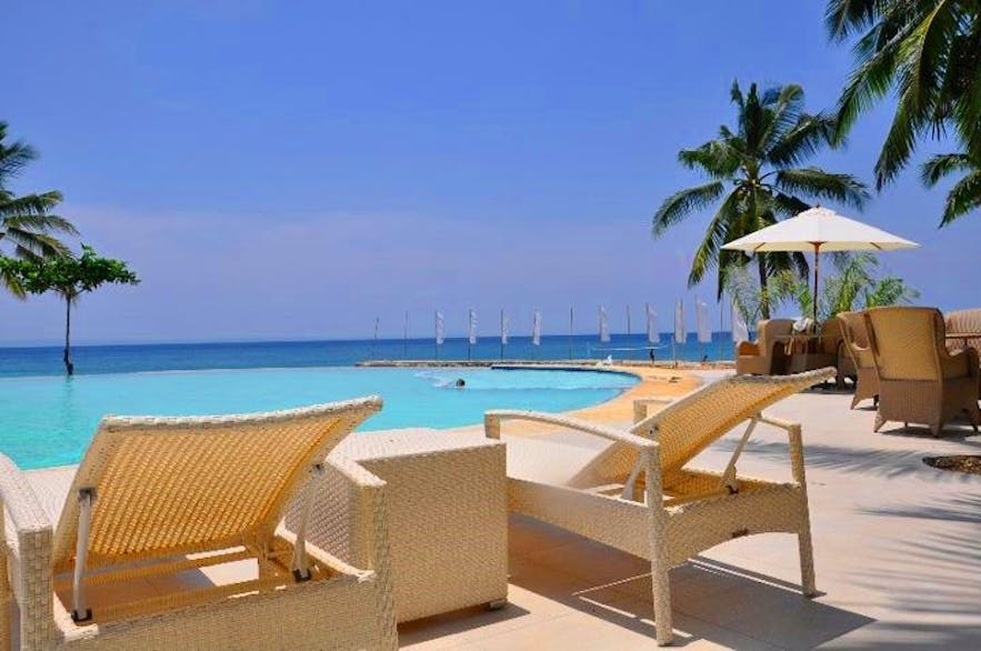 Lounge chairs by the pool in Mangodlong Paradise Beach Resort