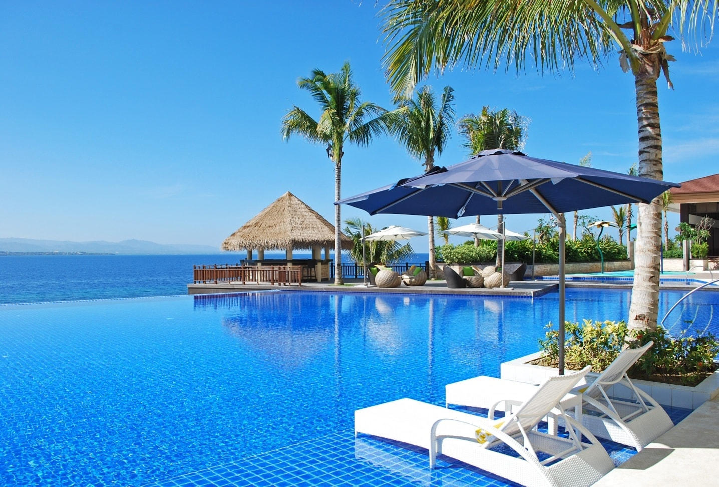 Overlooking view of the sea from the pool area in Dusit Mactan Resort