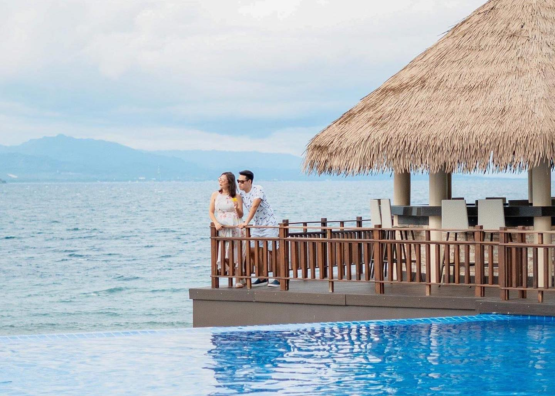 A couple enjoying the beautiful view from Dusit Mactan Resort
