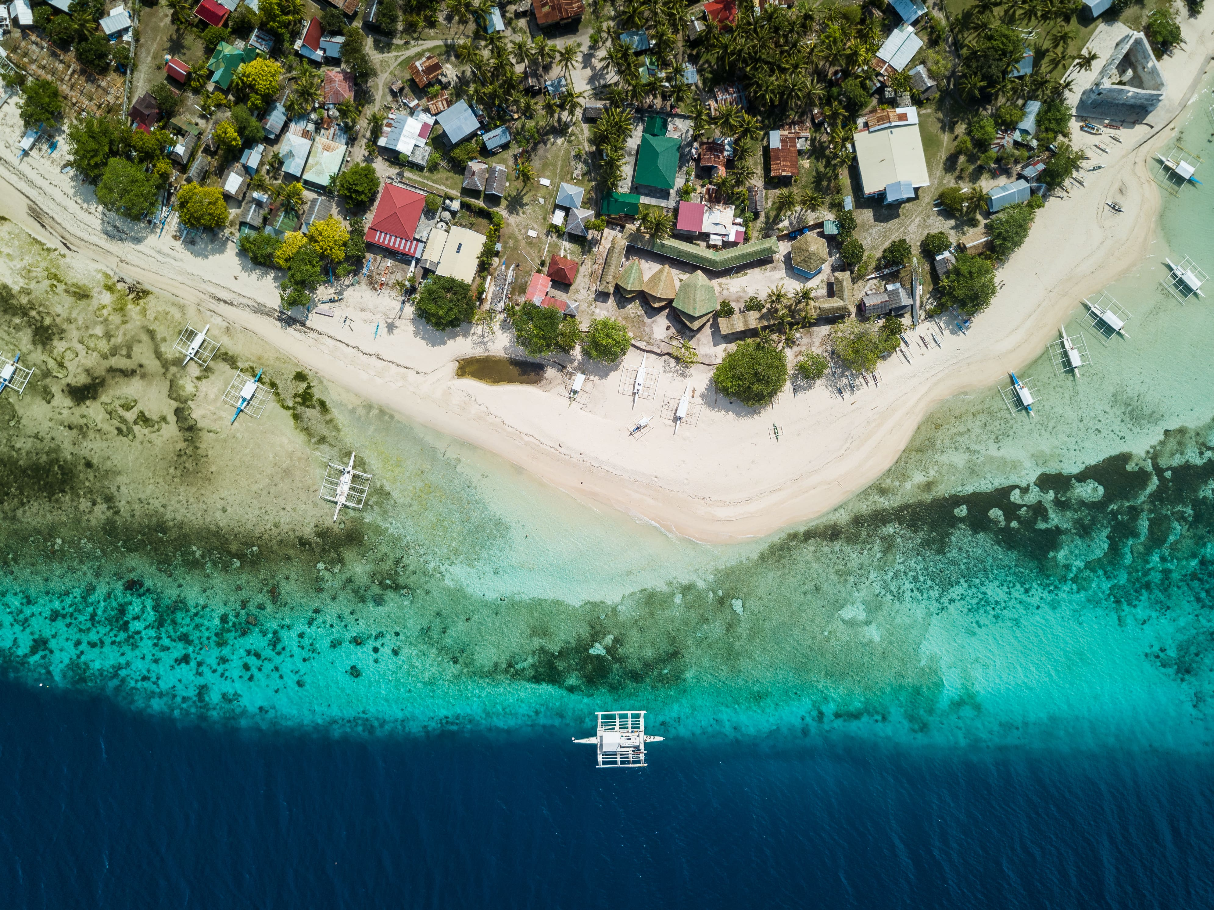 Aerial view of the blue waters of Pamilacan Island in Bohol