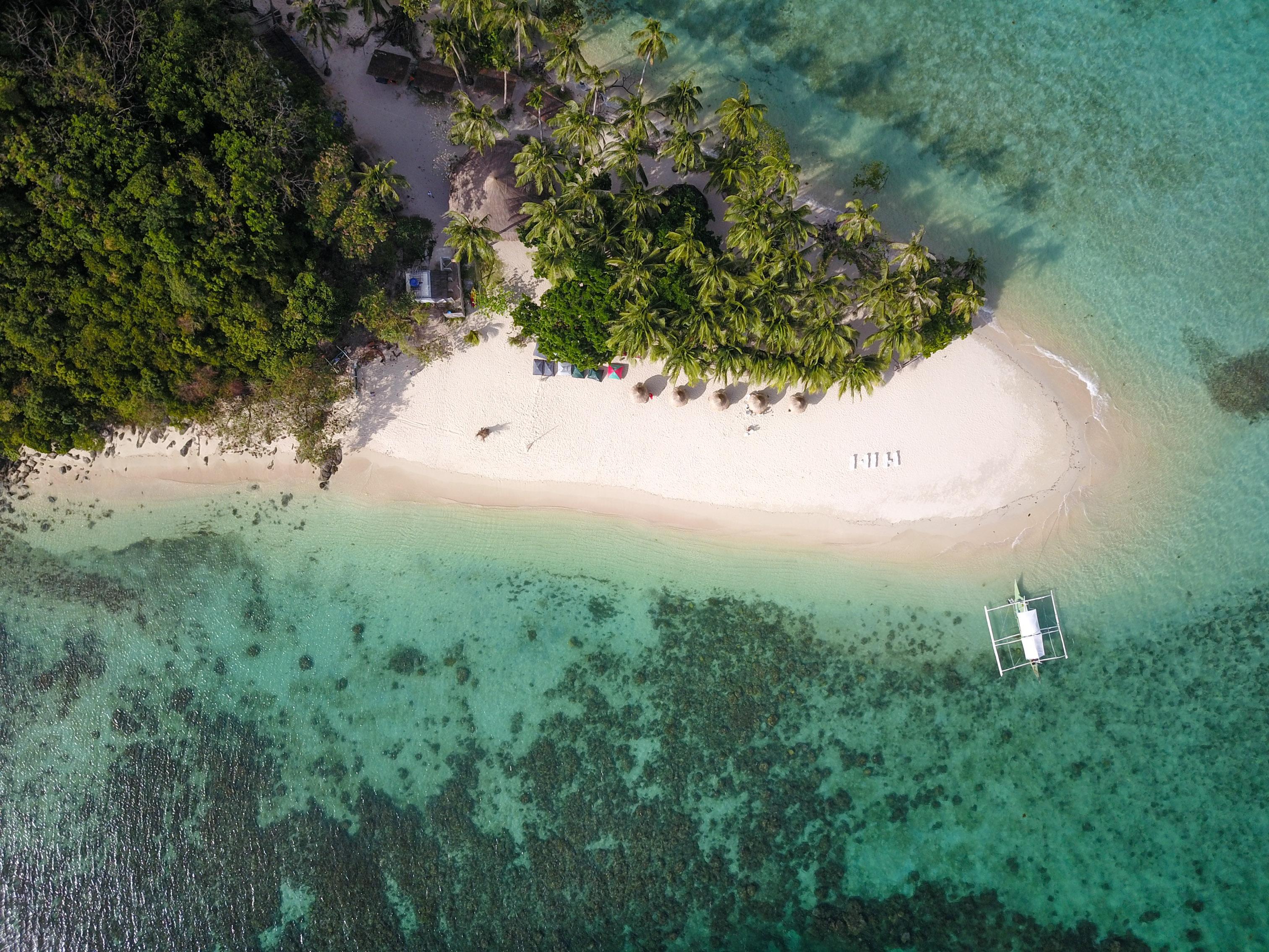White sand beach of Inaladelan Island in Port Barton Palawan