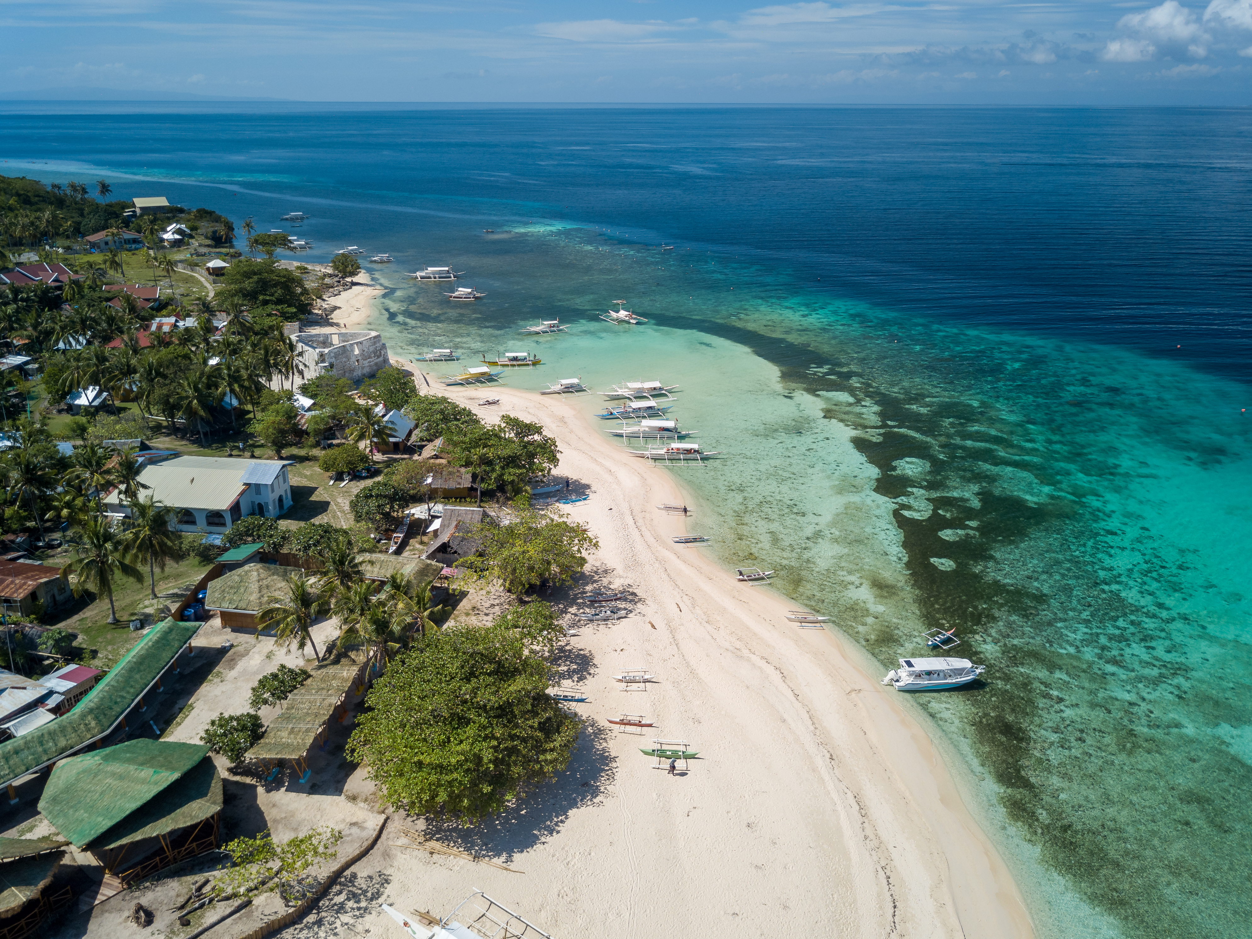 White sand beach and clear blue waters of Pamilacan Island in Bohol