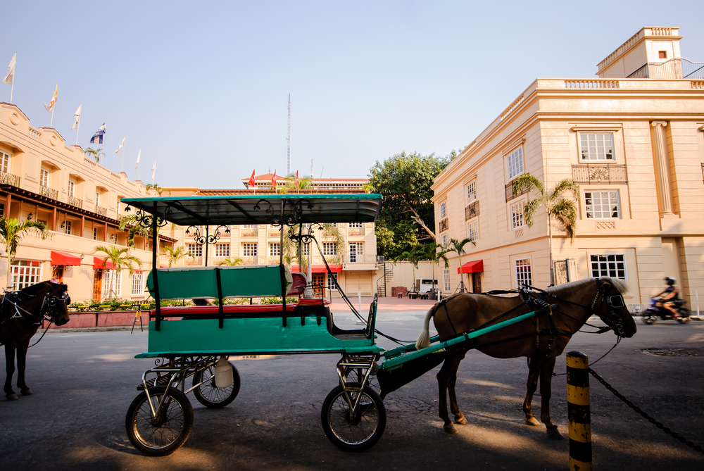 A horse-drawn carriage in front of Intramuros in Manila