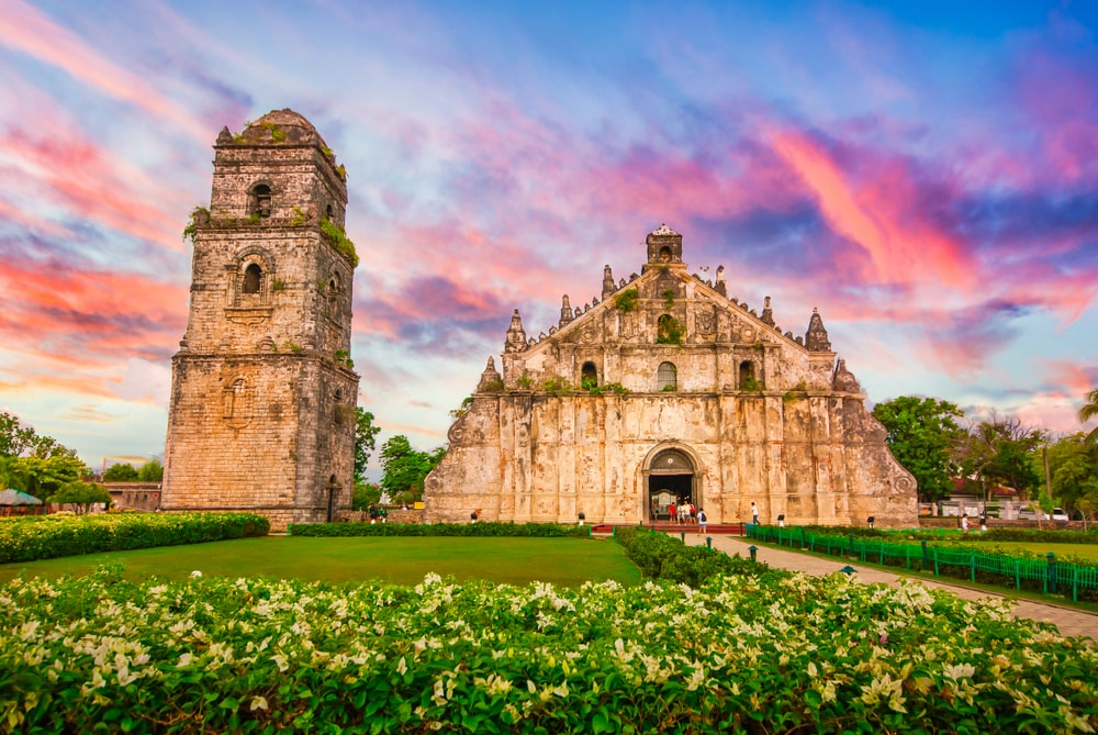 The colorful sunset complements the beauty of Paoay Church in Laoag