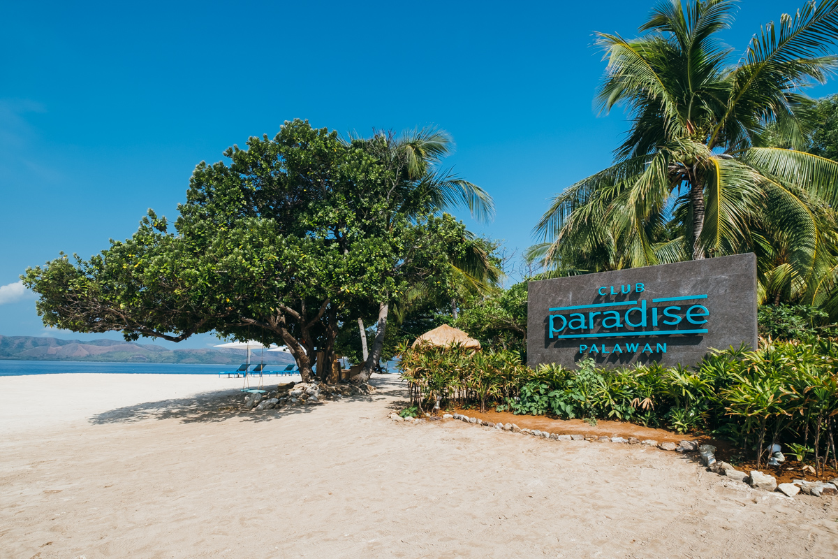Signage of Club Paradise found at the entrance of the Resort