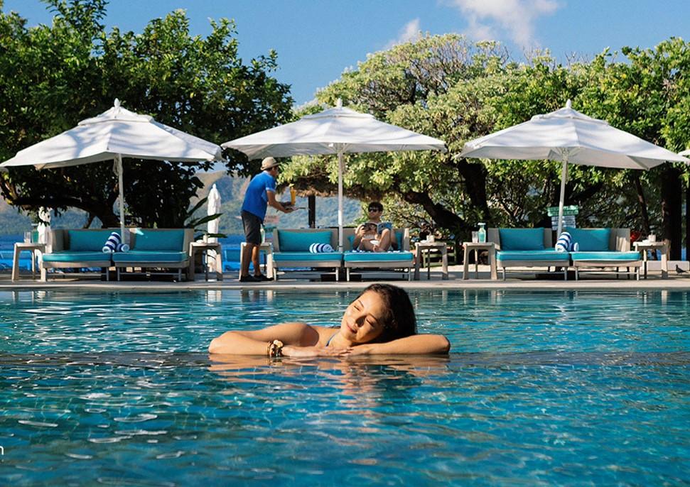 Woman enjoying the freshwater of Club Paradise Resort Pool