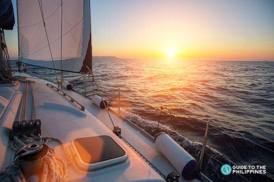 Watching the sunset while riding a yacht in Boracay