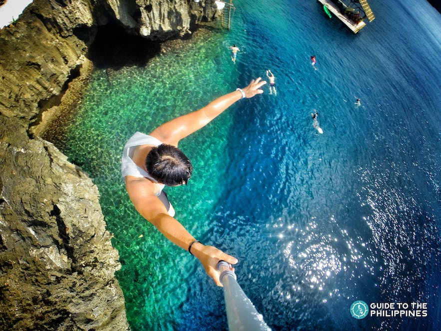A guy jumping from a cliff at Ariel's Point