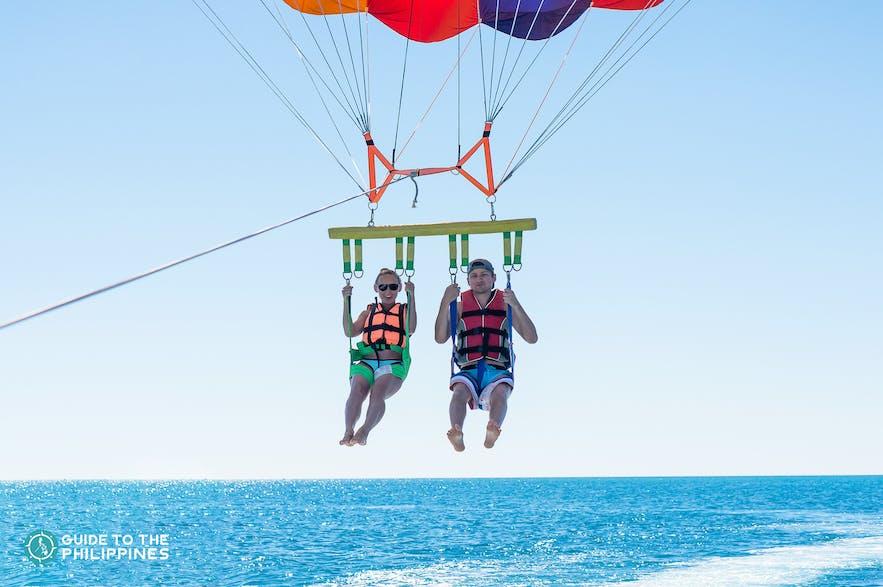 A couple parasailing in Boracay