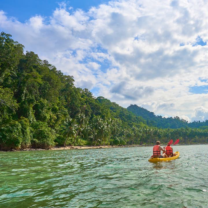 Two travelers kayaking in Port Barton in Palawan