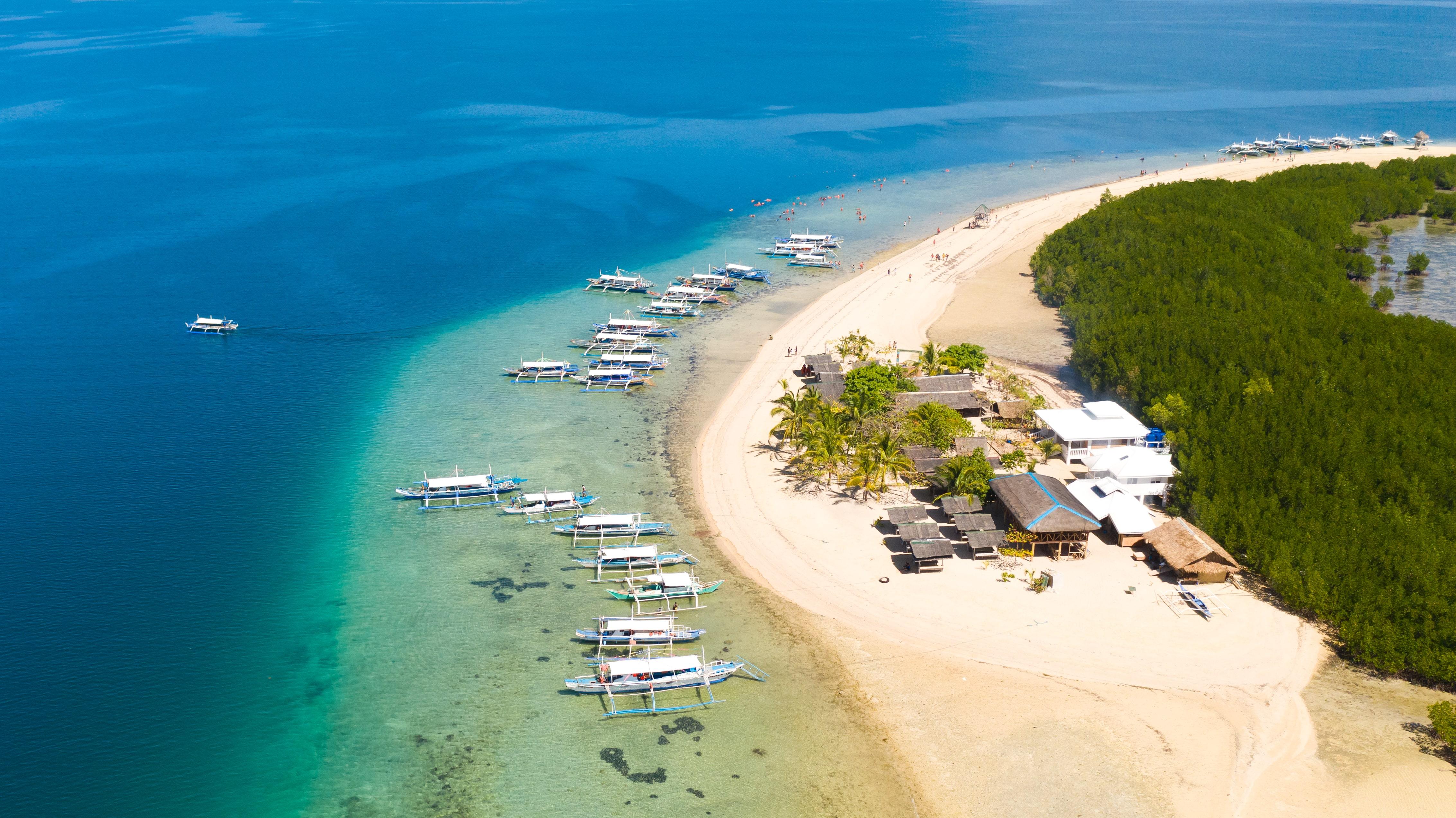 Boats docked on the beach of Starfish Island