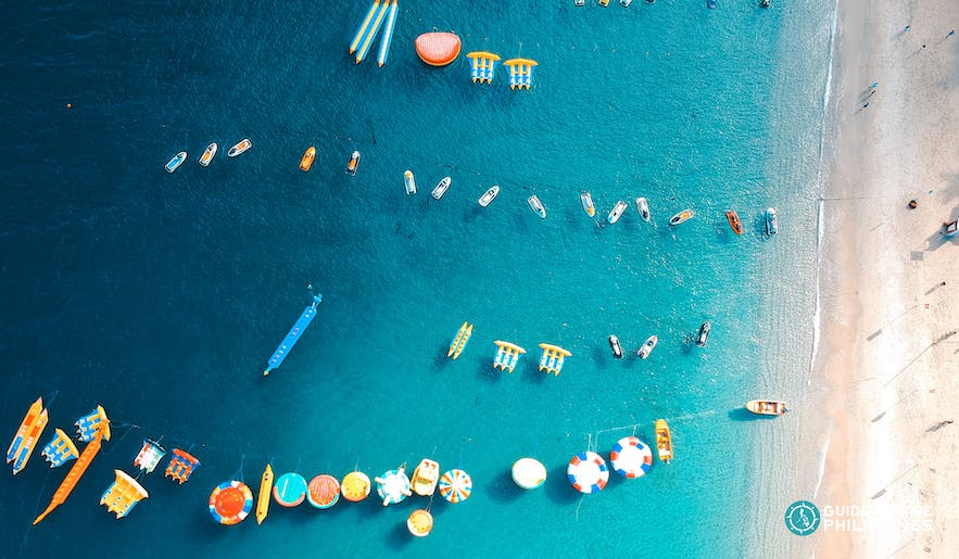 Floaters and water activities in White Beach, Puerto Galera