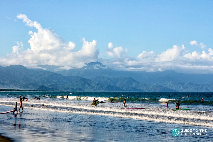 People surfing in Sabang Beach in Aurora