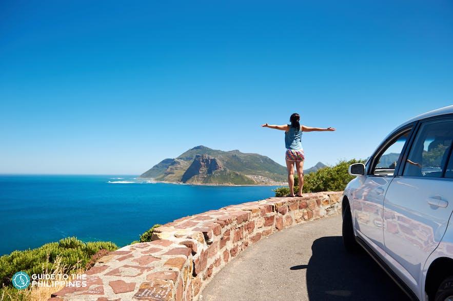 A girl enjoying the roadside view