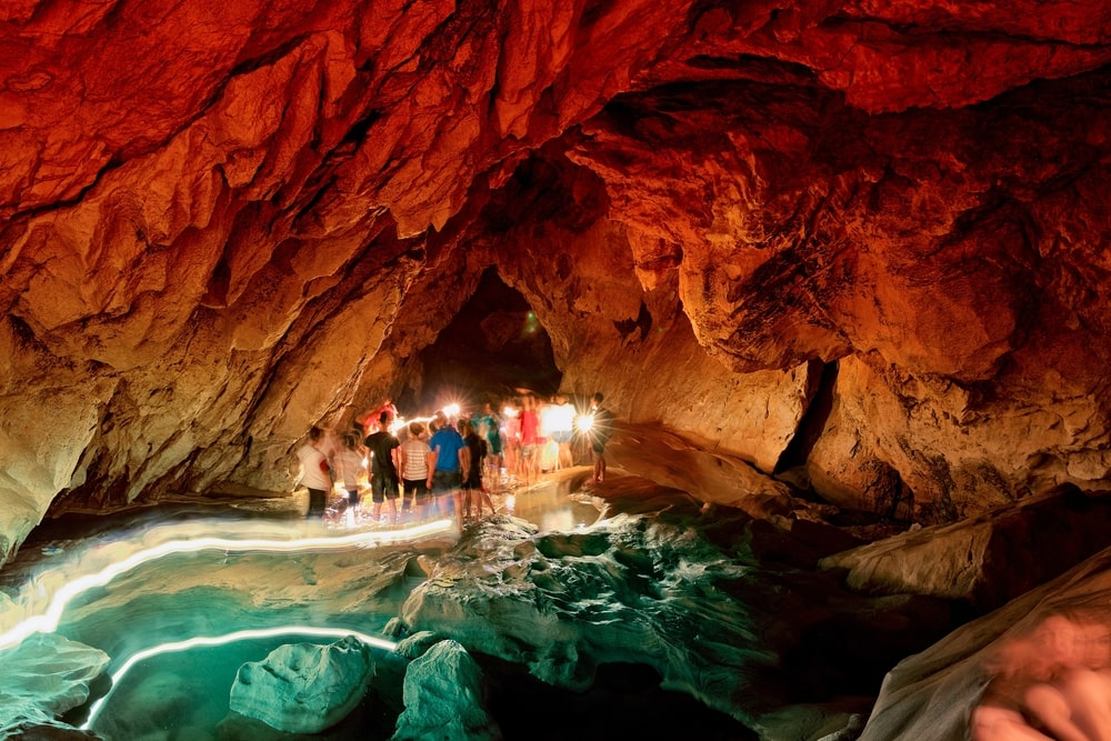 Tourists inside the Sumaguing Cave in Sagada