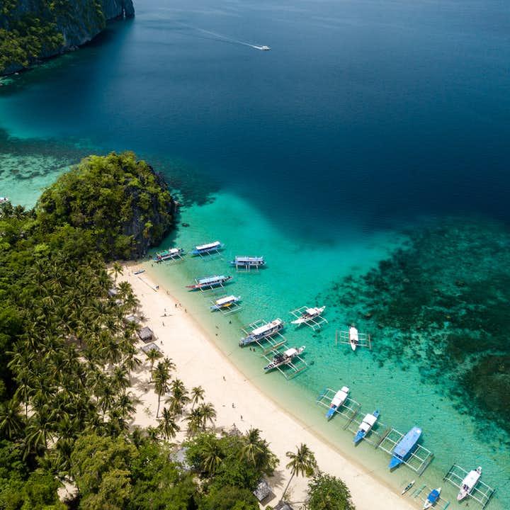 Boats docked at Seven Commandos Beach in El Nido Palawan