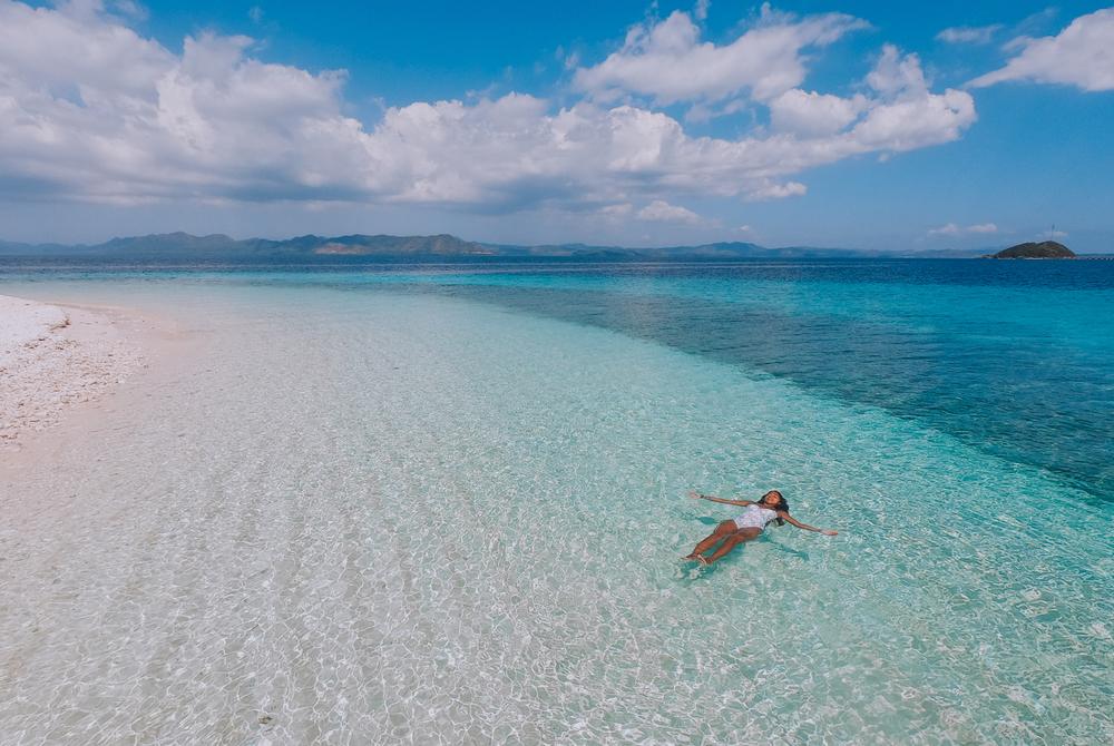 A woman enjoying the waters of Starfish Island in Palawan
