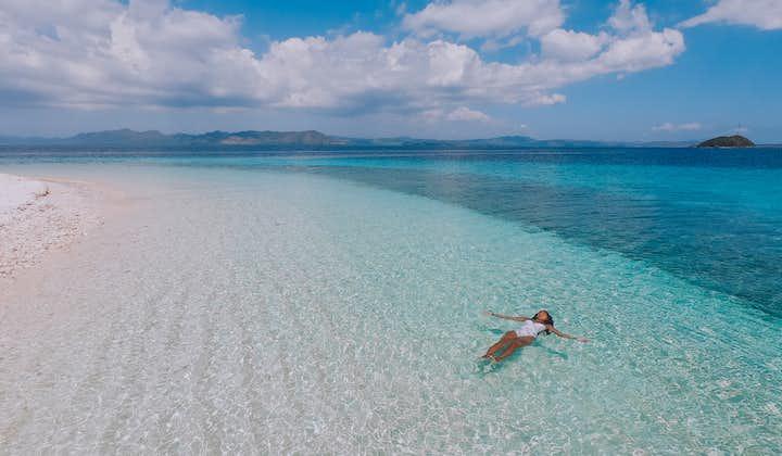A woman floating on the beautiful beach of Starfish Island