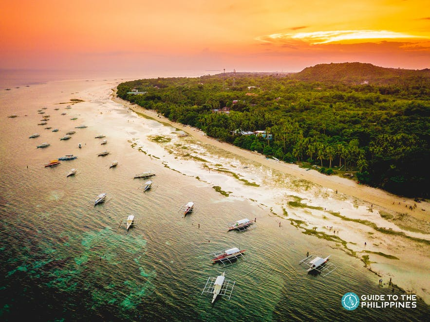 Sunset over the white-sand beach in Panglao