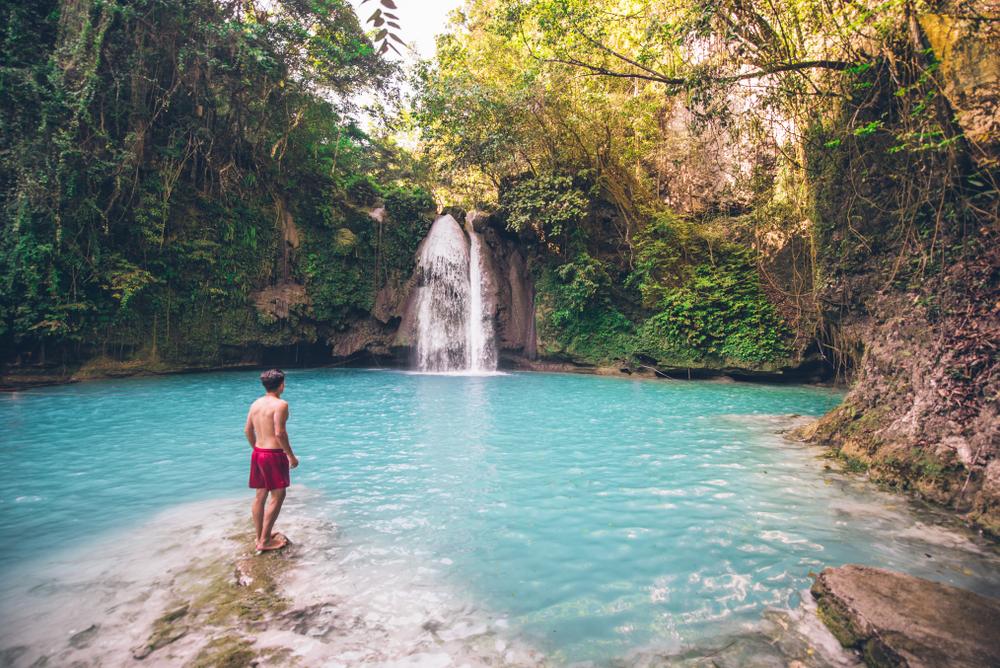 A man enjoying the view of Kawasan Falls