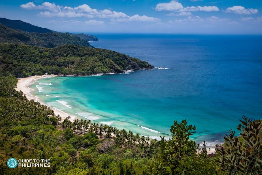 Blue waters of Sabang Beach in Puerto Princesa Palawan
