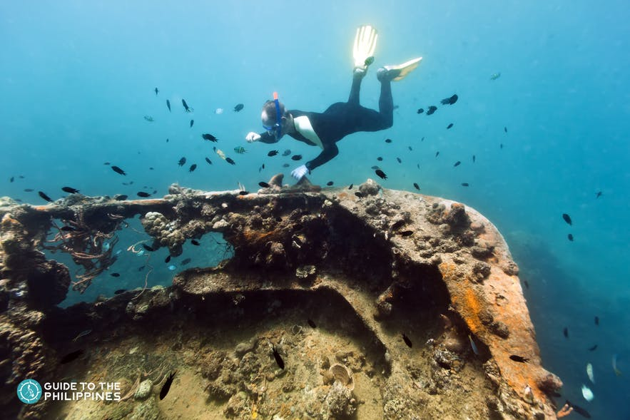 A diver exploring the wreck sites in Coron
