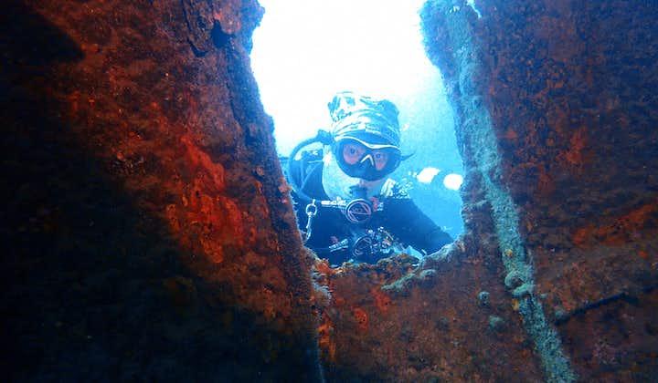 A diver in Alma Jane Wreck Puerto Galera