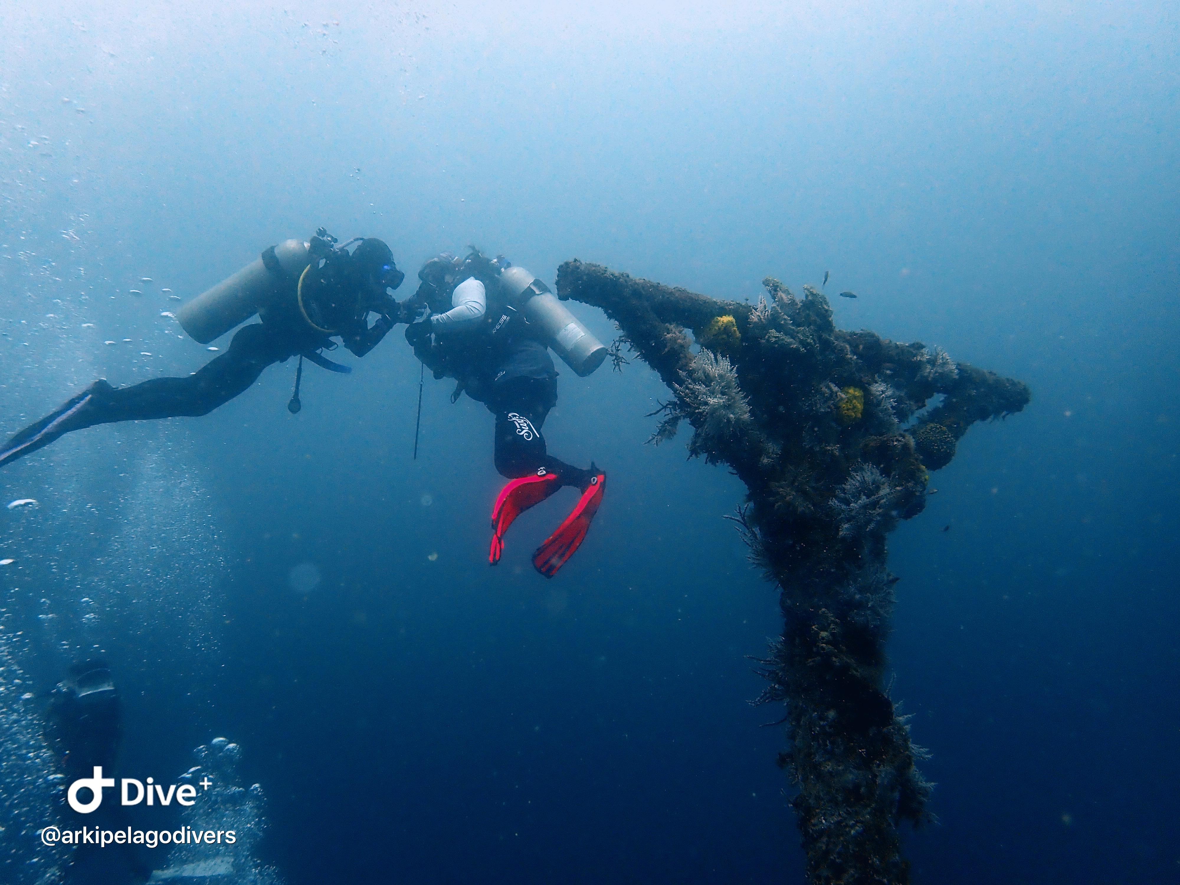 Two divers in Alma Jane Wreck Puerto Galera