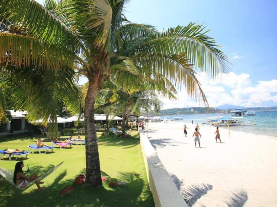 People playing at the beachfront area of Wild Orchid Beach Resort