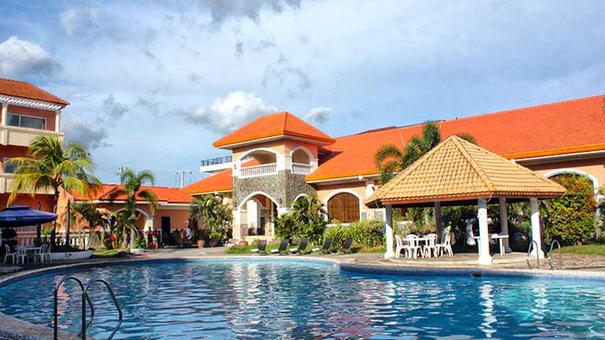 Pool area and Facade of Vista Marina Hotel and Resort