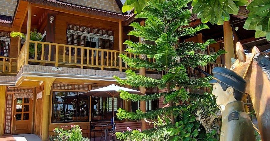 Facade of a wooden house in Punta Tierra Blanca Beach Resort