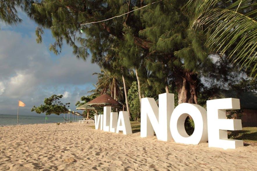 Villa Noe signage on the beachfront property
