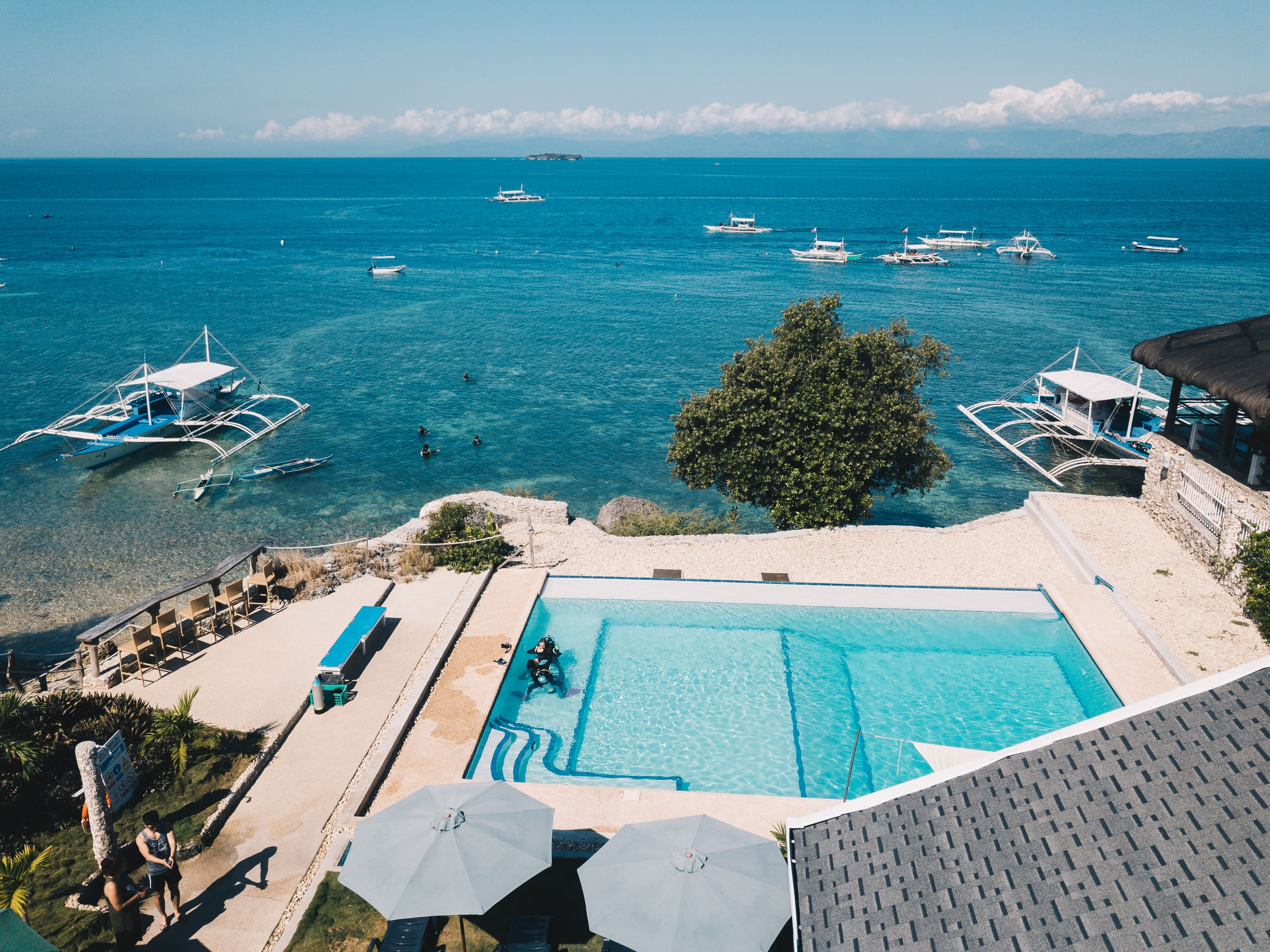 Pool of Seaview Dive Resort with an overlooking view of the ocean