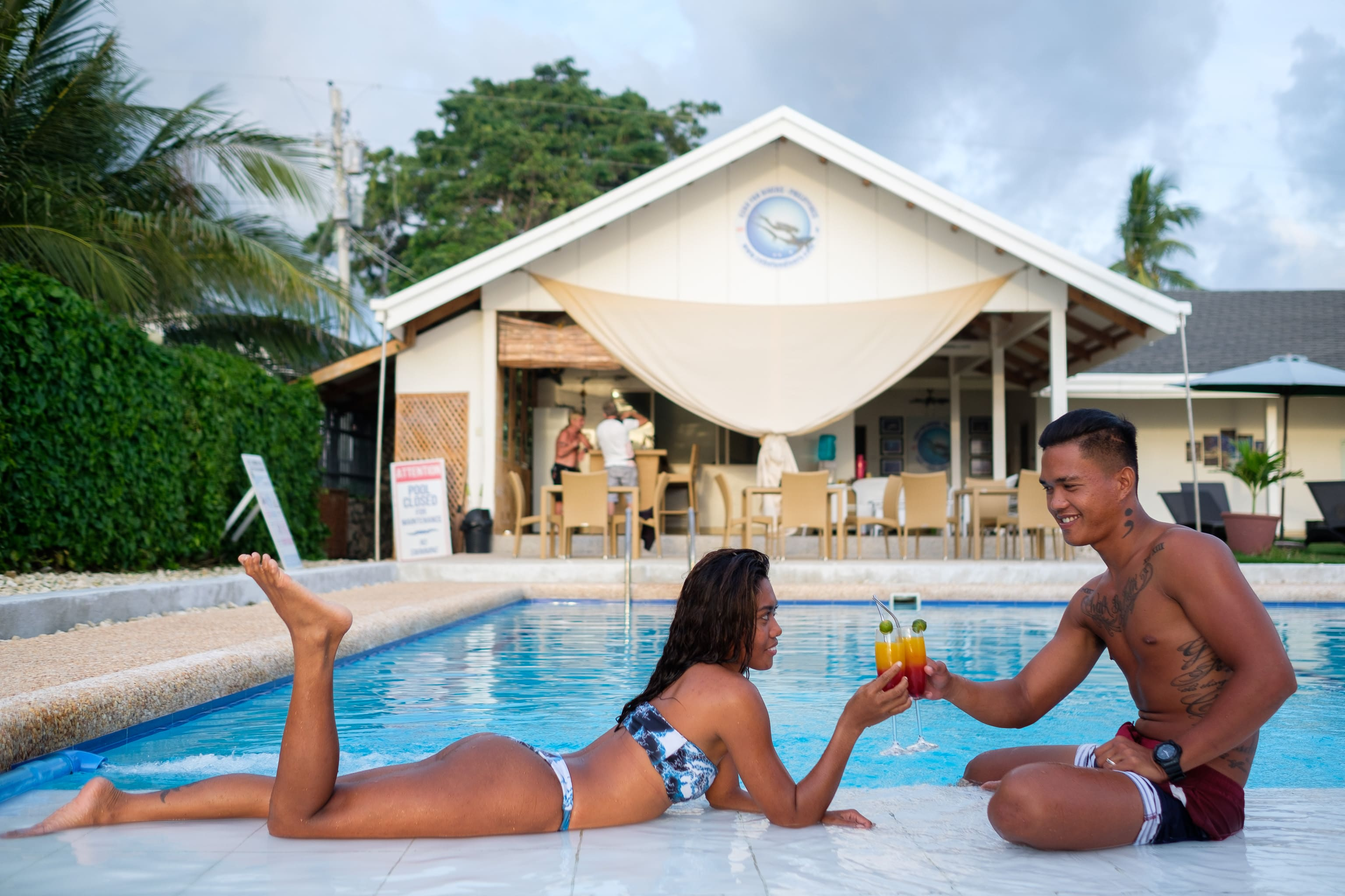 A couple enjoying their time at the pool of Cebu Seaview Dive Resort