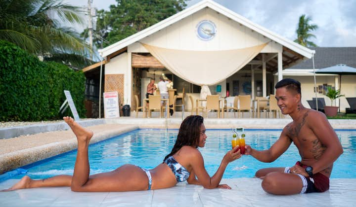 A couple drinking by the pool of Cebu Seaview Dive Resort
