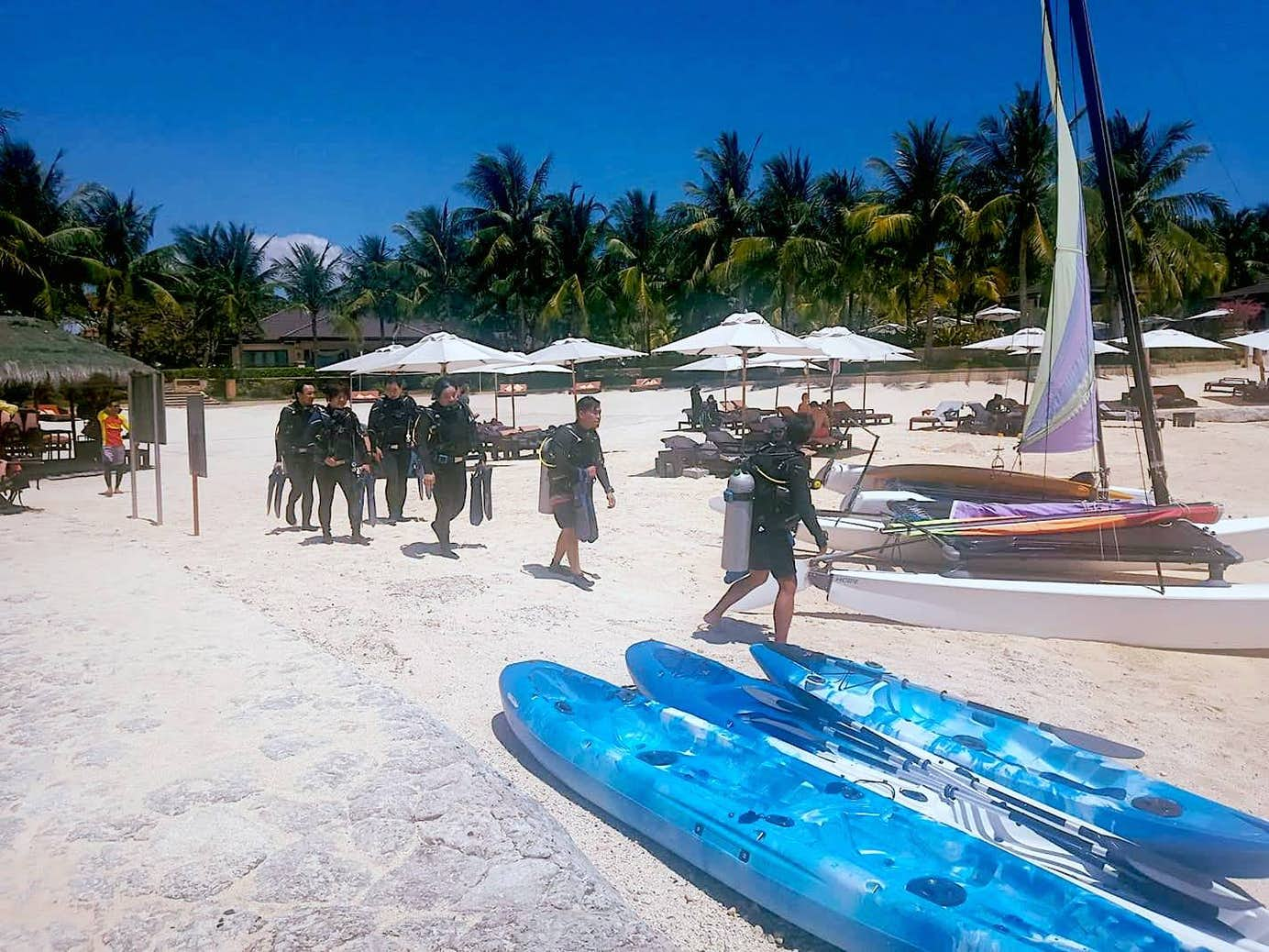 Divers about to board their boat for a diving session in Cebu