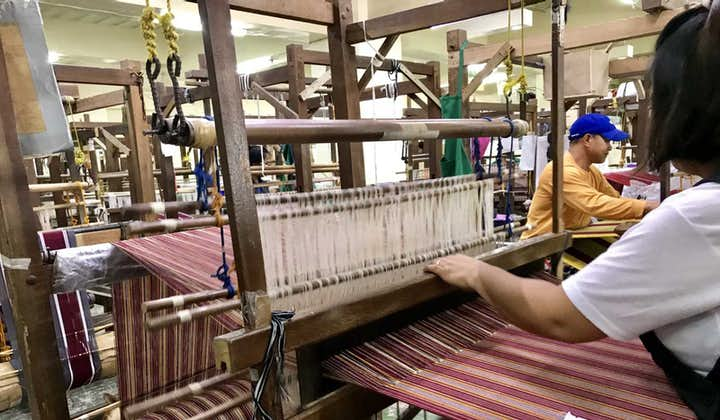 A woman weaving using a loom at Easter Weaving House in Baguio