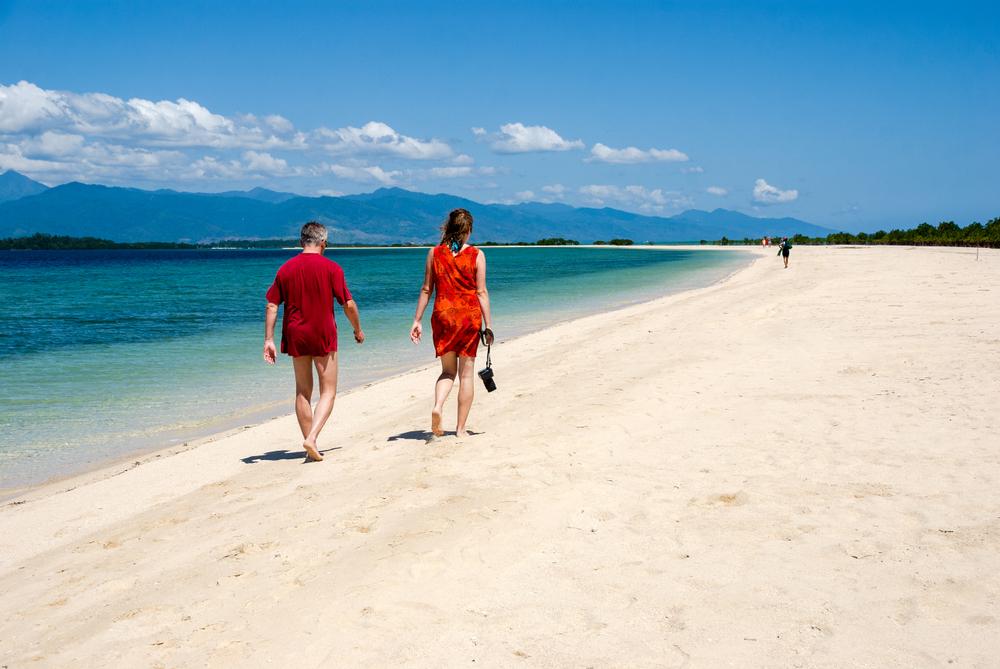 Couple walking by the beach of Honda Bay Palawan