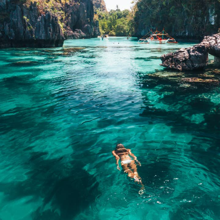 Woman enjoying the cool waters of Palawan