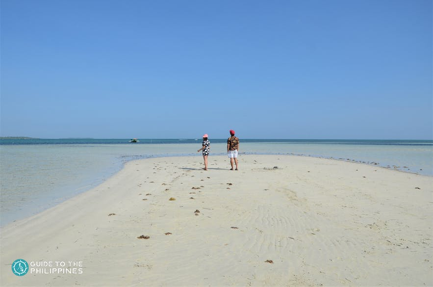 A couple stands on Tondol White Sand Beach in Pangasinan