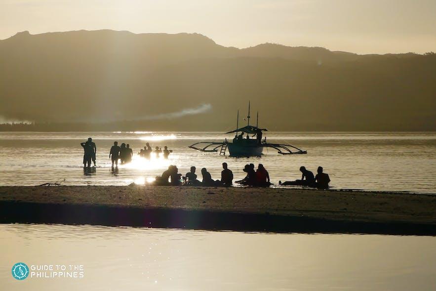 People watching the sunet on Alibijaban Island
