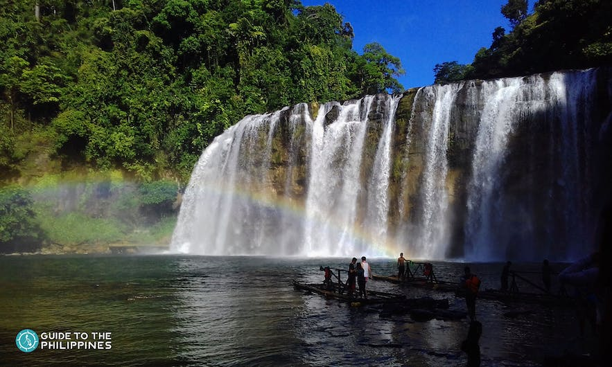 People float on a raft near the Tinuy-an Falls in Surigao Del Sur