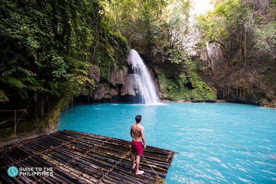 Man looking at Kawasan Falls in Cebu