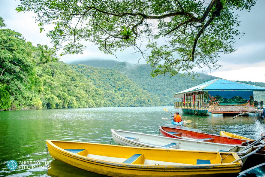 Boats and a floating hut on Bulusan Lake, Bicol